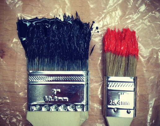 Paint brushes with paint on them