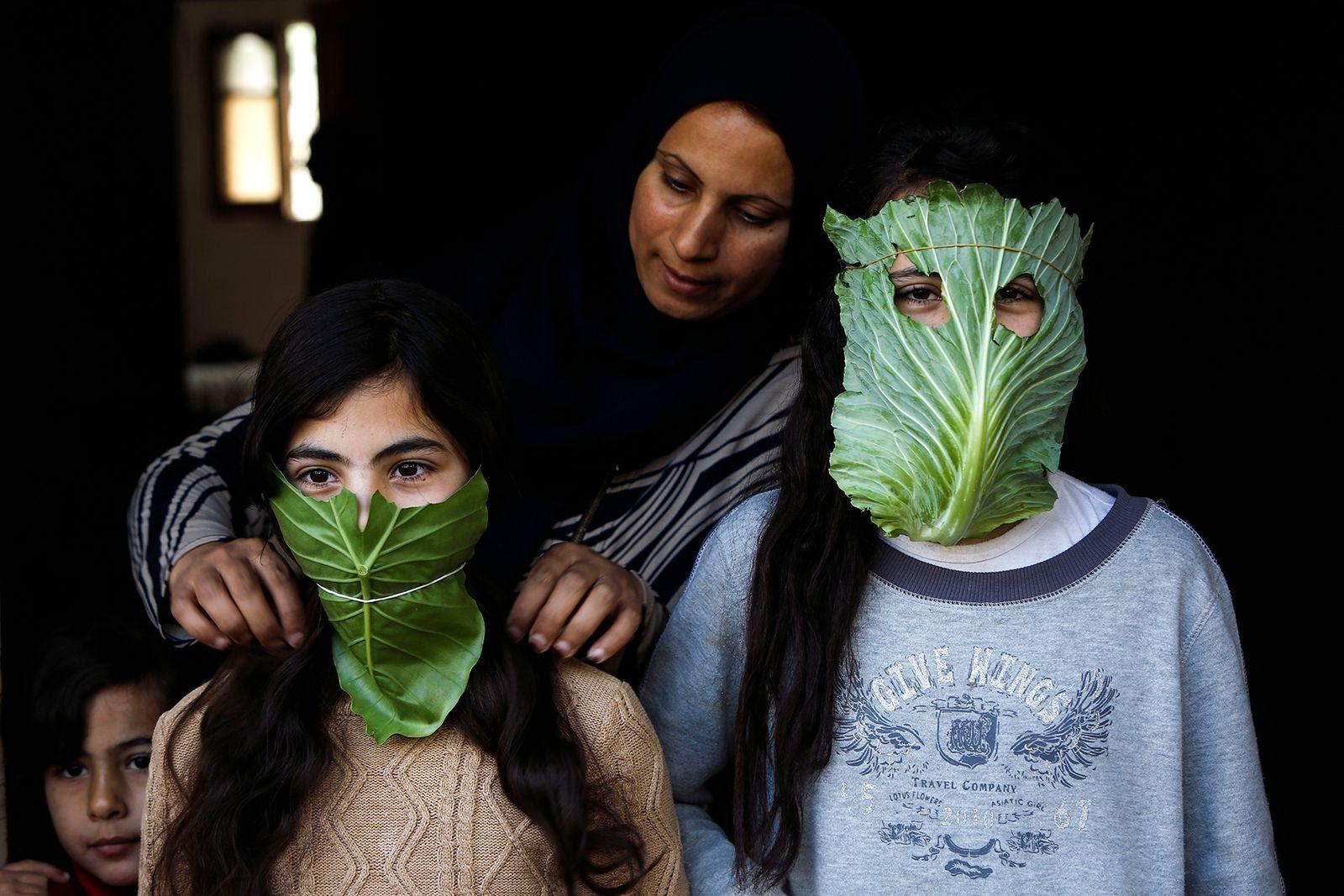mother putting lettuce masks on kids